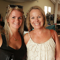 Meg Butler, left, and Beth Terrell pose for a photo during Fashion On Front Thursday August 21, 2014 at Bakery 105 in Wilmington, N.C.(Jason A. Frizzelle)