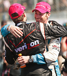 LONG BEACH, CA - APR 15: IndyCar Series driver Simon Pagenaud congratulates IndyCar Series driver Will Power after winning the 2012 Toyota Grand Prix of Long Beach. All fees must be ageed prior to publication,.Byline and/or web usage link must  read SILVEX.PHOTOSHELTER.COM Photo by Eduardo E. Silva