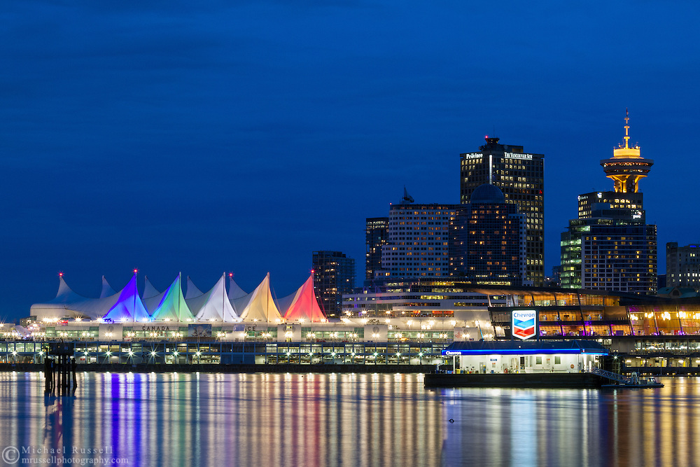 Floating gas station, Canada Place and the Trade and Convention Center in the early evening in Vancouver, British Columbia, Canada