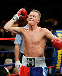 Undefeated featherweight Jason Litzau poses after knocking out Carlos Contreras in 6th round.  The bout took place on the undercard of the Arturo Gatti vs Thomas Damgaard IBA Welterweight Championship bout at Boardwalk Hall in Atlantic City, NJ.