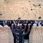 Praying at the Western Wall of King Solomon's Temple is the holiest site in Judiasm. Old city, Jerusalem, Israel