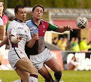 Twickenham, Surrey, ENGLAND, 29.04.2006, Giants, Robbie Paul, [left] Quins Lee Hopkins right,passes the ball, during the Super League match Quins RL vs Huddersfield Giants, at The Stoop,  © Peter Spurrier/Intersport-images.com,Rugby League .