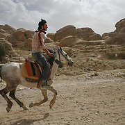 A Jordanian man rides a horse at the  historical and archaeological city of petra in southern Jordan, may 13, 2013. Photo by Oren Nahshon