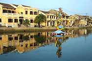 Hoi An Architecture - Much of the city's commerce still revolves along the riverbank of the Thu Bon River as well as most of its ochre colored UNESCO World Heritage buildings.