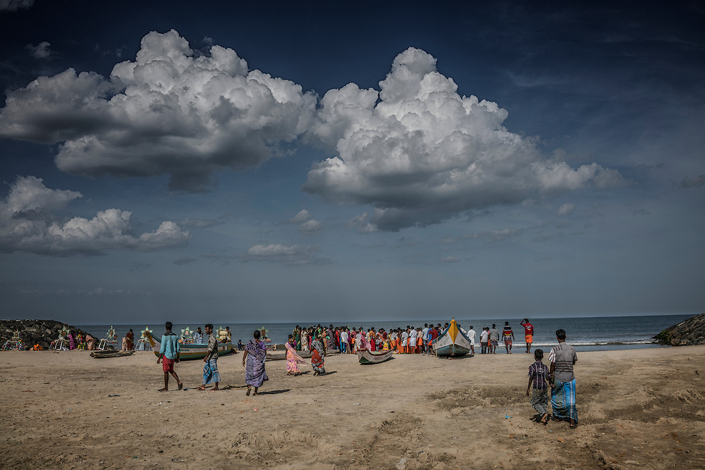 A crowd from the village of Tiruchchepuram gather to watch a ritual where village men drop into a trance as part of the Ganesh Chaturthi Festival.  Tamil Nadu, India.