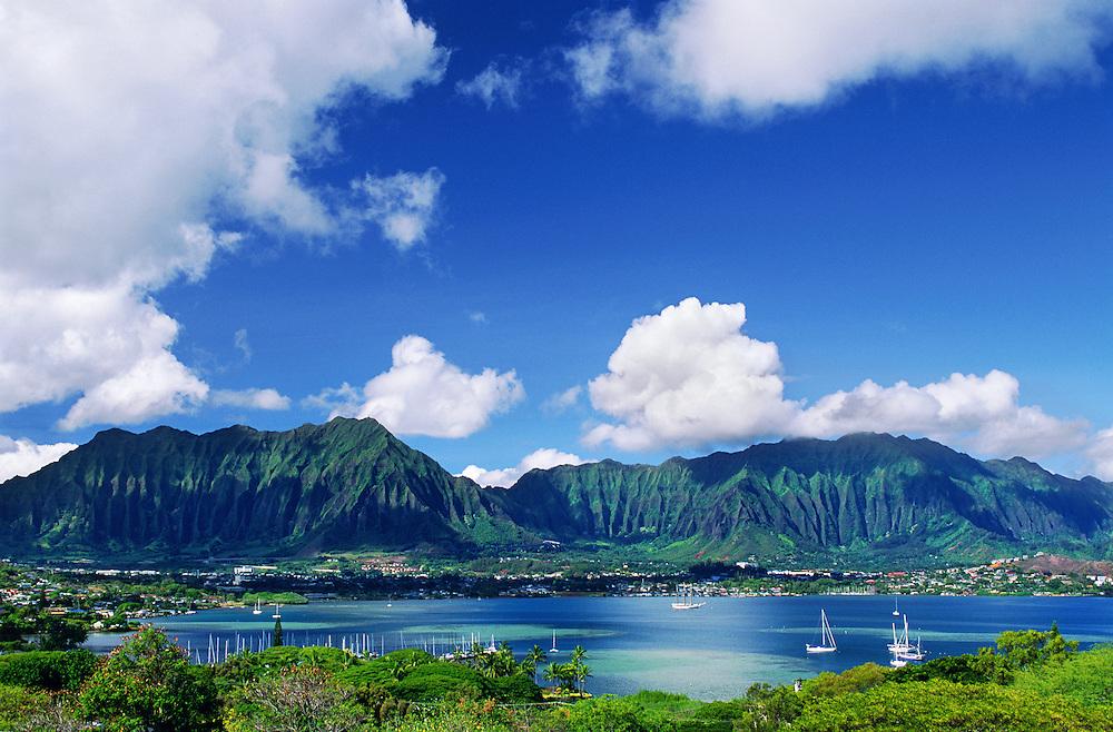Kaneohe Bay on the windward coast of Oahu with the Pali (cliffs) of the Koolau Mountains behind; Hawaii.
