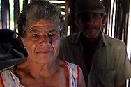 Woman and her husband in an isolated house between Gibara and Caletones in Holguin Province, Cuba. Their life is very hard.