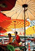 Umbrellas shade the fresh market