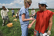 Nursing students at Emory University School of Nursing in Atlanta, Georgia, give checkups in the camps of migrant workers. The migrant workers come to the clinic for general check up. The students often go into the fields to check workers while they break.