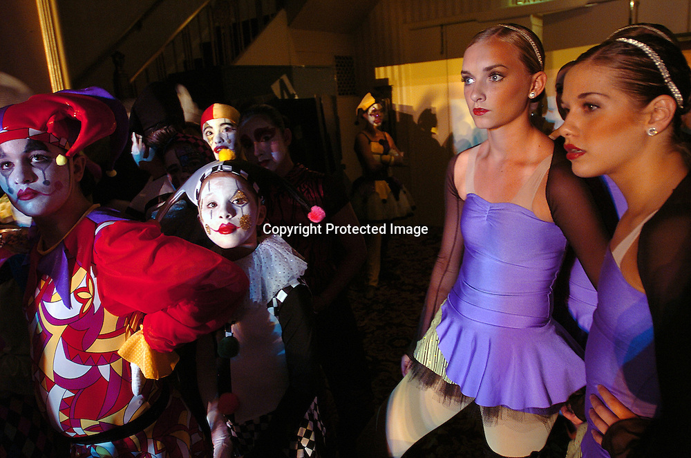 Dancers from the Dance Club(r) of Orem, Utah and Harlequin Extravaganza(l) watch another group's performance during the New York Dance Alliance's national competition finale July 5, 2005 in New York City.<br />