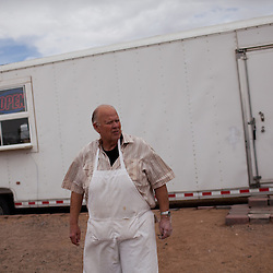 Philip Skinner is seen outside his sandwich shop in Columbus, New Mexico. Recently federal authorities arrested the mayor, police chief, and trustees who were allegedly operating an illegal gun running ring.