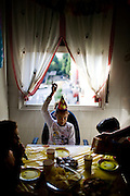 Izaskun celebrates her birthday with her classmates at her parents apartment in Bilbao. Llanire and Izaskun's parents are a mixed couple. She is from Bilbao and her partner is from Colombia.