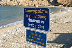 No nude sunbathing sign in English and Greek on the beach in Naxos, Greece