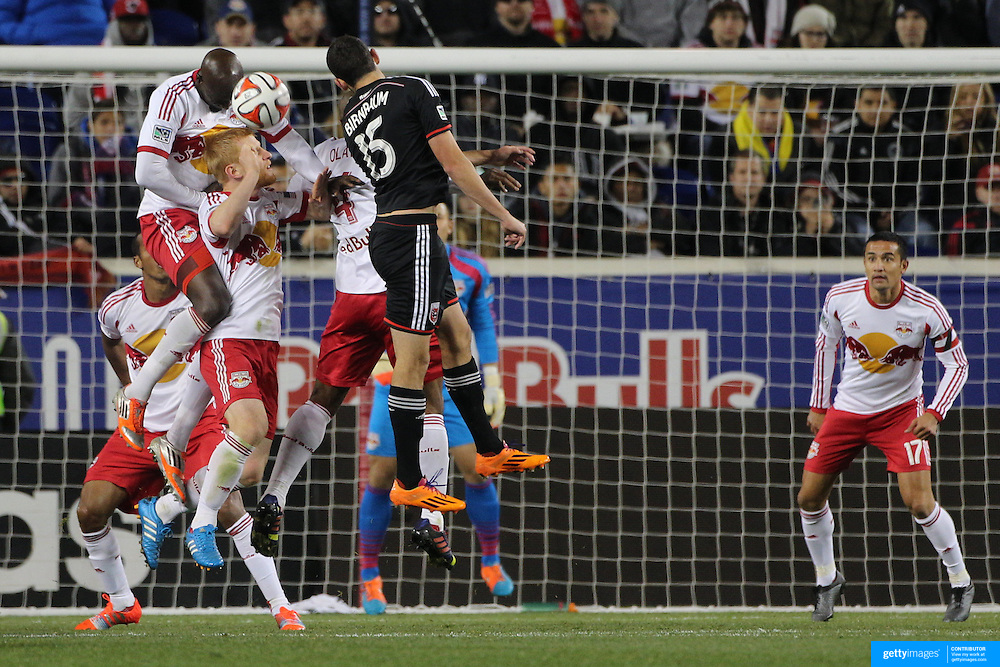 New York Red Bulls defenders Ibrahim Sekagya, Richard Eckersley and Jamison Olave, clear while challenged by Steve Birnbaum, DC United, during the New York Red Bulls V DC United, MLS Cup Playoffs, Eastern Conference Semifinals first leg at Red Bull Arena, Harrison, New Jersey. USA. 2nd November 2014. Photo Tim Clayton