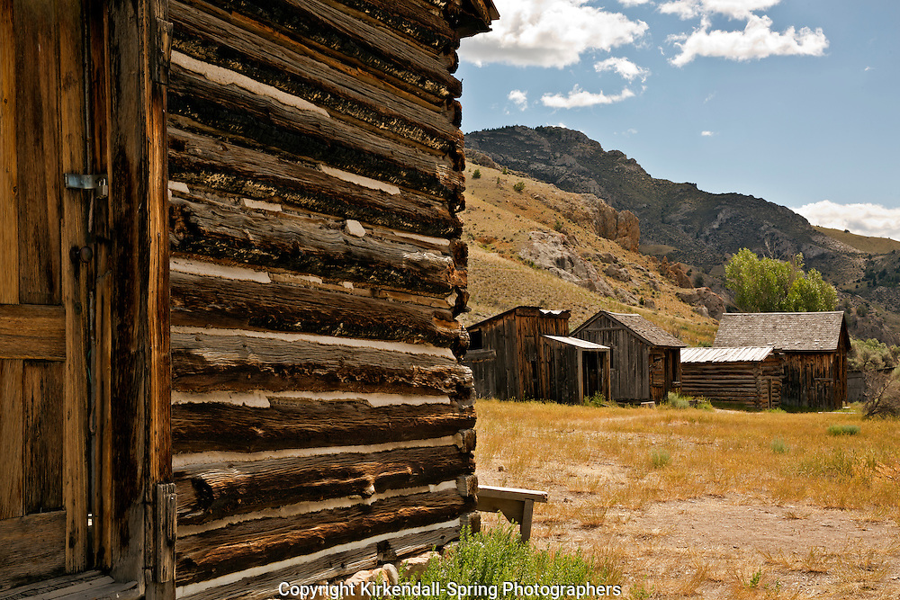 MT00055-00...MONTANA - Old log buildings at the ghost town of Bannack in Bannack State Park.