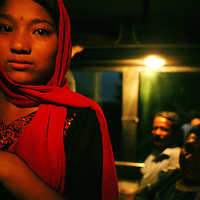 A young girl rides the night bus to Kathmandu on June 9, 2006. (Photo/Scott Dalton)