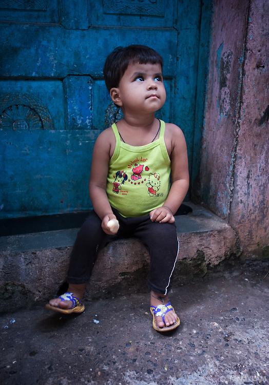 Boy with an Ice Cream - Dharavi, Mumbai, India