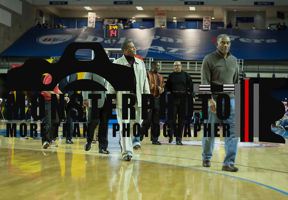 Members of the undefeated 1973 Howard Wildcats basketball team leave the floor after being recognized for their accomplishments during half time of a NBA D-league regular season basketball game between the Delaware 87ers (76ers) and the Springfield Armor (Nets) Saturday, Dec. 28, 2013 at The Bob Carpenter Sports Convocation Center, Newark, DE.<br /> <br /> The 73 Wildcats went 24-0 becoming the first boys basketball team in the state-tournament era to finish undefeated.