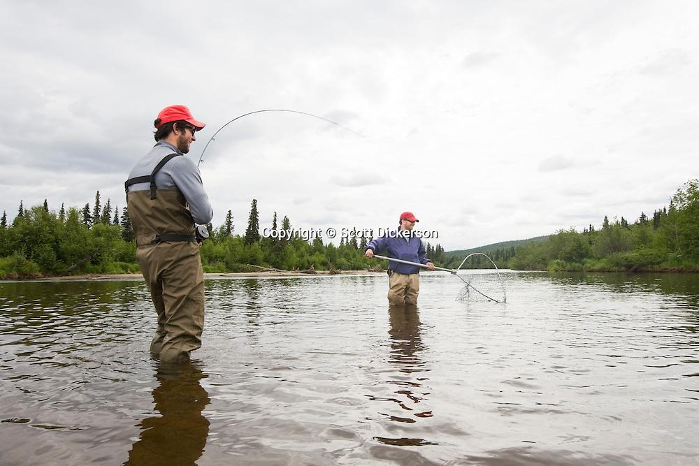 Sport fishermen fishing sockeye salmon on the koktuli for Salmon fishing bay area