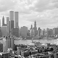 The World Trade Center, Lower Manhattan, Brooklyn Heights, the Brooklyn Bridge and the East River waterfront in July or August, 1974. The image comes from a high-quality 35mm black and white negative and prints well at sizes up to at least 12 x 18 inches.