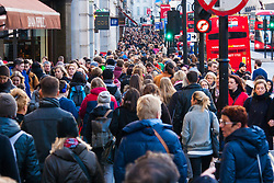 """London, December 20th 2014. Tens of thousands of shoppers descend on central London to scoop up pre-Christmas bargains as retailers offer discount incentives on """"Panic Saturday"""". PICTURED: Crowds of Christmas shoppers pack London's Regents Street."""