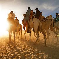 Tuareg camel riders in the Sahara desert at sunrise, Timbuktu, Mali.