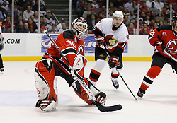 April 26, 2007; East Rutherford, NJ, USA; New Jersey Devils goalie Martin Brodeur (30) reacts to the puck as Ottawa Senators right wing Dany Heatley (15) comes in from behind during the second period at Continental Airlines Arena in East Rutherford, NJ.