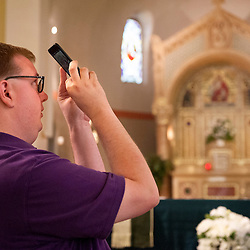 2 AUG. 2015 -- ST. LOUIS -- Matt DeWitt photographs following Mass Mob III at Sts. Teresa and Bridget Catholic Parish in St. Louis Sunday, Aug. 2, 2015. The event brings Catholics from across the Archdiocese of St. Louis to worship at historic, urban parishes.<br /> <br /> Photo by Sid Hastings.