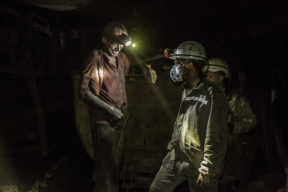 Miners greet each other inside the Shcheglovskaya Coal Mine on Friday, March 25, 2016 in Makiivka, Ukraine.