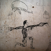 Graffittis are pictured on the wall of a cell at the central prison in the district of Wango, in the capital Bangui.