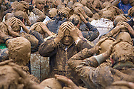 Mourning shiite muslim men, in trance and covered with mud, self-flagellating during the Day of Ashura, in the town of Bijar, Iran.