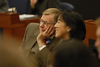 Ohio State President E. Gordon Gee (left) and Fisher College of Business Dean Christine Poon (right) at the 'Conversation on the Economy,' a forum held at Pfahl Hall in the Fisher College of Business at Ohio State on Nov. 30, 2010..