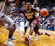 WEST LAFAYETTE, IN - MARCH 09: Austin Hollins #20 of the Minnesota Golden Gophers dribbles the ball along the baseline against the Purdue Boilermakers at Mackey Arena on March 9, 2013 in West Lafayette, Indiana.  (Photo by Michael Hickey/Getty Images) *** Local Caption *** Austin Hollins