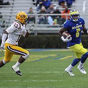 Albany cornerback Jamal Merritt (13) attempts to tackle  Delaware wide receiver Jamie Jarmon (6) near the 45 yard line during a week nine Colonial Athletic Association Conference game between the Delaware Blue Hens and the Albany Great Danes Saturday, Nov. 07, 2015 at Tubby Raymond Field at Delaware Stadium in Newark, DE.
