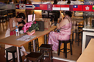 Two woman wait in a restaurant, Yangon, Burma.<br />