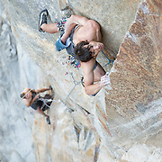 "Belayed by Tommy Caldwell, Alex Honnold makes the second free ascent of the third  (12+/13-) pitch of ""Wet Lycra Nightmare"" (13d) on Leaning Tower, Yosemite N.P."