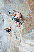 """Belayed by Tommy Caldwell, Alex Honnold makes the second free ascent of the third  (12+/13-) pitch of """"Wet Lycra Nightmare"""" (13d) on Leaning Tower, Yosemite N.P."""