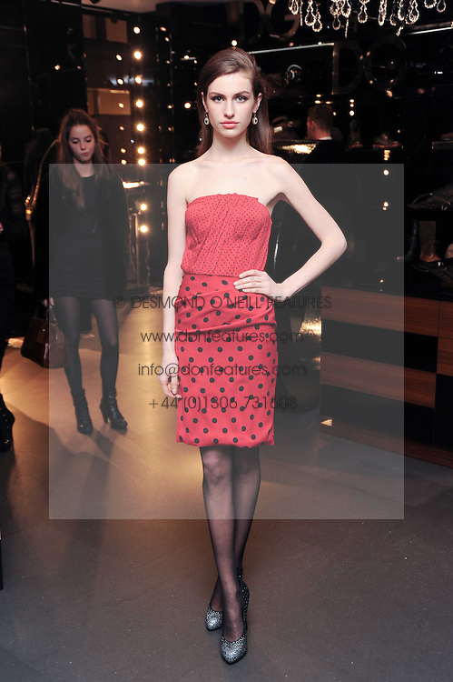 TALI LENNOX at a party hosted by InStyle to celebrate the iconic glamour of Dolce & Gabbana held at D&G, 6 Old Bond Street, London on 3rd November 2010.
