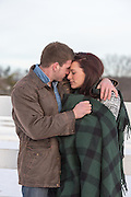 couple outdoors embracing and wrapped in a blanket