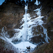 Ice surrounds and piles up at the base of Multnomah Falls, a 542-foot (165 m) tall waterfall located in the Columbia River Gorge, Oregon. The waterfall typically ices over once or twice each winter after extended periods of below-freezing temperatures.