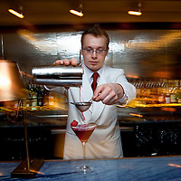 UK. London. A barista making cocktails in Corrigan's Restaurant in Central London..Photo©Steve Forrest/Workers' Photos.