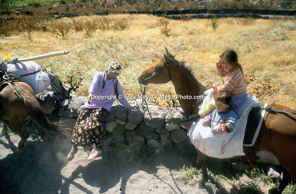 MOUNT ARARAT, TURKEY, AUGUST 2002.A Kurdish nomadic family comes down the mountain.  Mount Ararat is with its 5137 meters the highest mountain in Turkey. It has been closed to foreigners until 2001, due to guerilla activity on the mountain. Photo by Frits Meyst/Adventure4ever.com