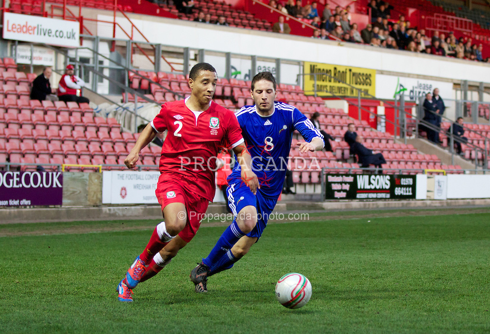 WREXHAM, WALES - Wednesday, February 29, 2012: Wales' Adam Henley (Blackburn Rovers) and Andorra's Xavier Viera (Atletico De Monzon) during the UEFA Under-21 Championship Qualifying Group 3 match at the Racecourse Ground. (Pic by Vegard Grott/Propaganda)