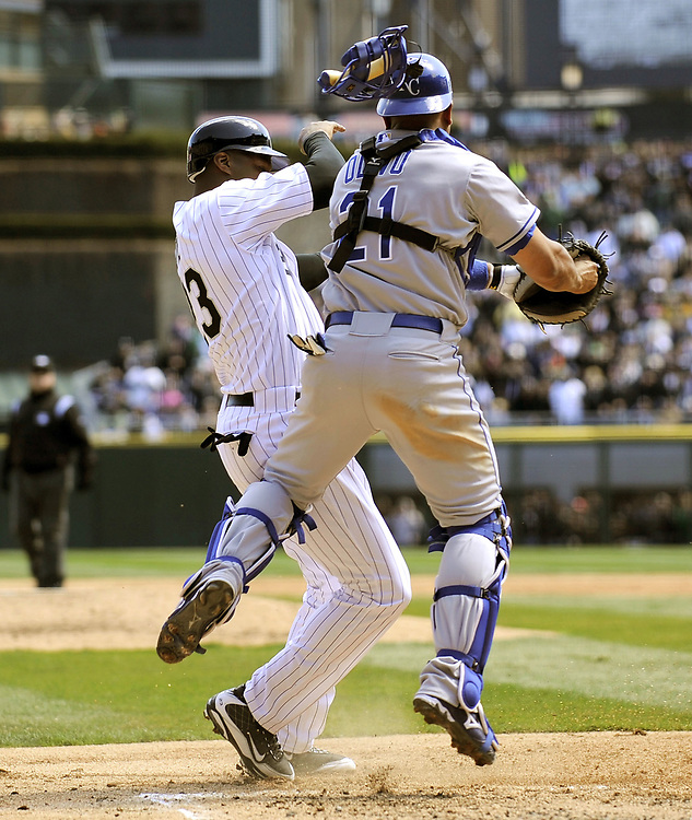 CHICAGO - APRIL 07:  Jermaine Dye #23 of the Chicago White Sox is tagged out at home plate by Miguel Olivo #21 of the Kansas City Royals in the second inning on April 7, 2009 at U.S. Cellular Field in Chicago, Illinois.  The White Sox defeated the Royals 4-2.  (Photo by Ron Vesely)