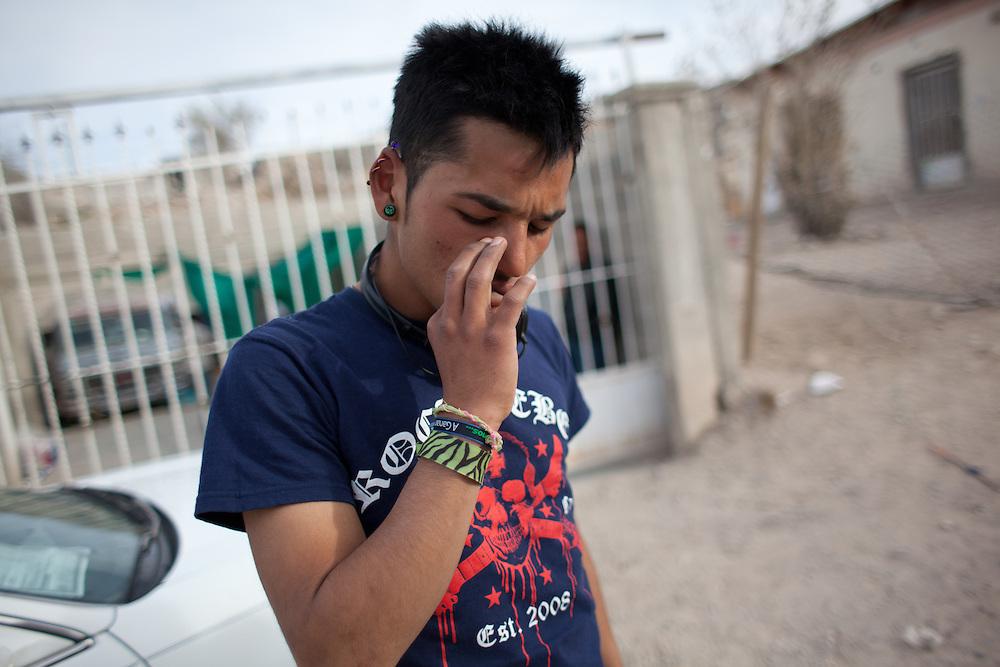 Manny smokes marijuana outside his home in Ciudad Juarez, Mexico.