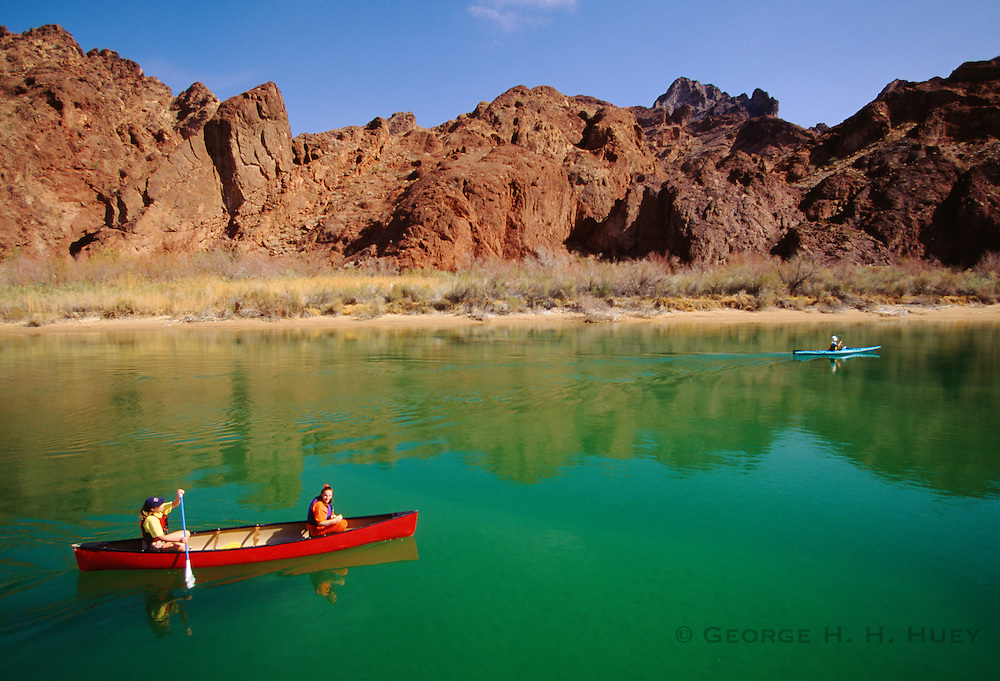 350166-1005 ~ Copyright: George H.H. Huey ~ Canoe with two females and a kayak in Topock Gorge, Colorado River, with adjacent Needles Wilderness Area. Havasu National Wildlife Refuge, Arizona.
