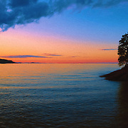 &quot;Chasing Sunset Oil Painting&quot;<br /> <br /> Stunning oil painting of a sunset and silhouette. Beautiful trees in silhouette in the right foreground with gorgeous orange, and blue hues of Lake Superior at sunset.