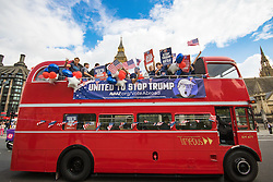 "London, September 21st 2016. A ""Stop Trump"" open topped red London double-decker bus passes the Houses of Parliament and Big Ben in London in a bid to encourage US expats to register to vote in the Presidential election, expecting the majority of them to be more inclined to support Hilary Clinton."