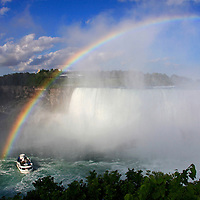 Canada, Ontario, Niagara Falls. Rainbow over the Maid of the Mist at Niagara Falls.