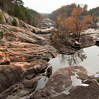 """This is the historical great falls of the Catawba River in Chester County, SC. In 1907 the river was diverted for hydro production to power cotton mills, and these rocks have been exposed as a """"dry bed"""" ever since. In 2007 with Duke Energy's hydro relicensing process, Duke agreed to once again pass water through the dam over these rocks for whitewater paddling. The town of Great Falls, which has lost all three of its cotton mills, is economically depressed and hopes that outdoor recreation will some day be a boon to its economy."""